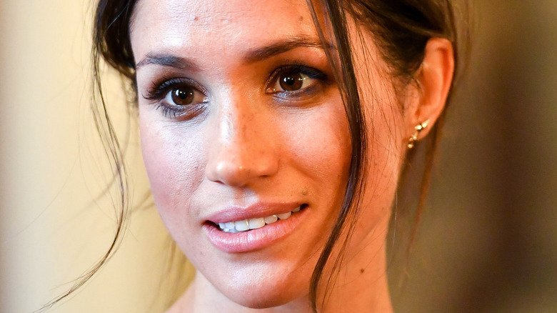 Meghan Markle smiling at a royal event
