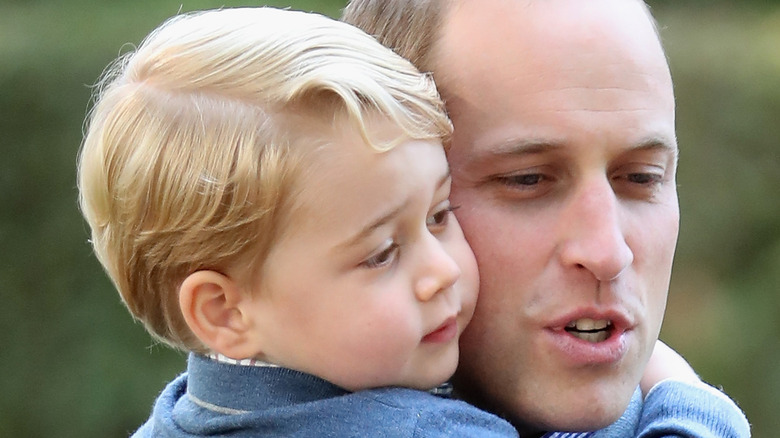 Prince George cuddles up to father Prince William