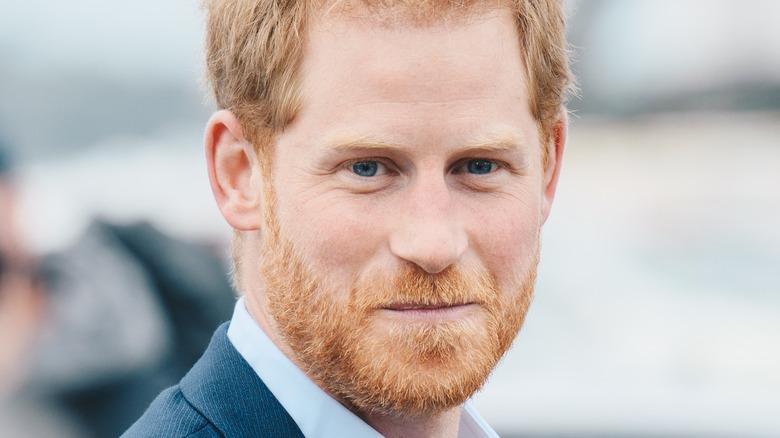 Prince Harry in blue jacket