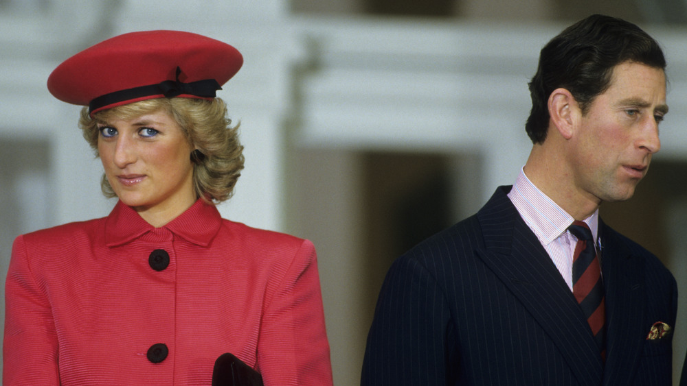Prince Charles and Princess Diana looking in different directions