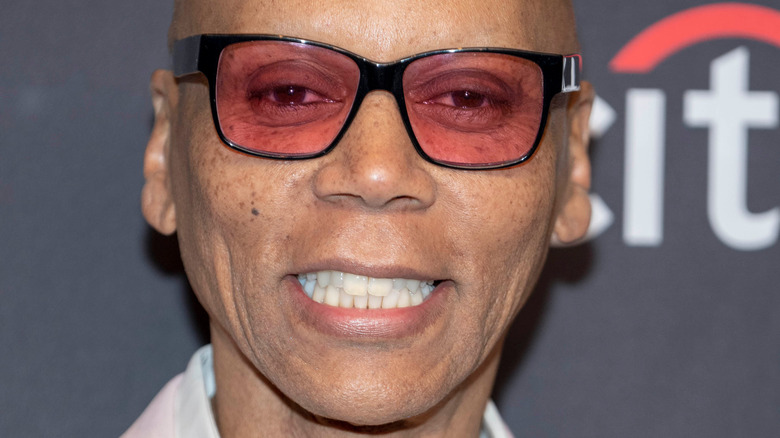 RuPaul smiling attending an event