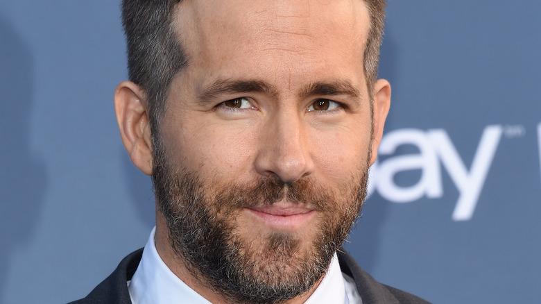 Ryan Reynolds with beard smiling