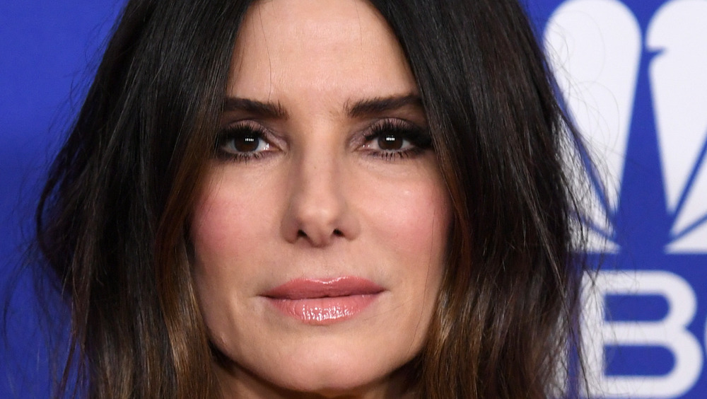 Sandra Bullock with middle part looking serious