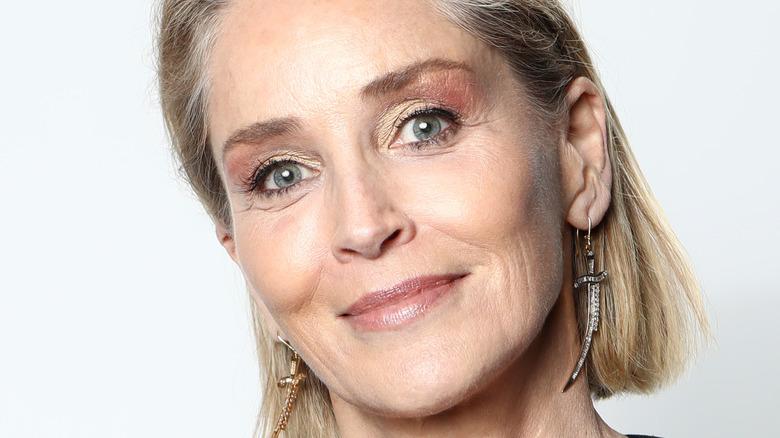 Sharon Stone wearing dagger earrings