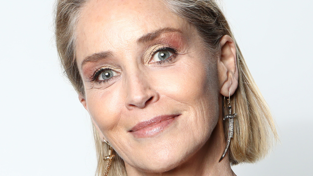 Sharon Stone grinning head cocked