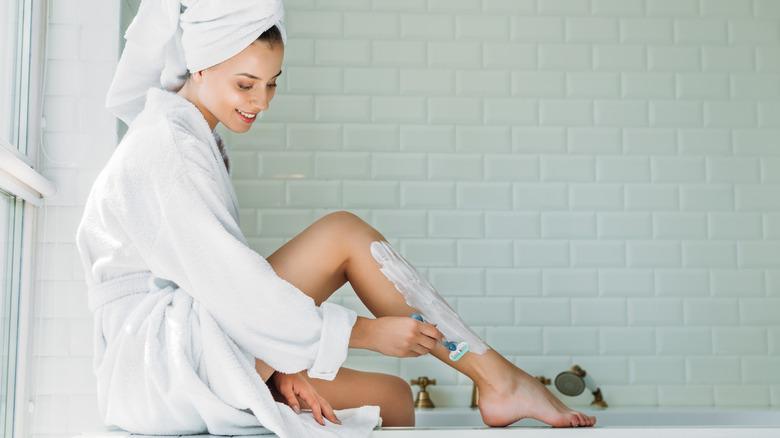 Person shaving legs
