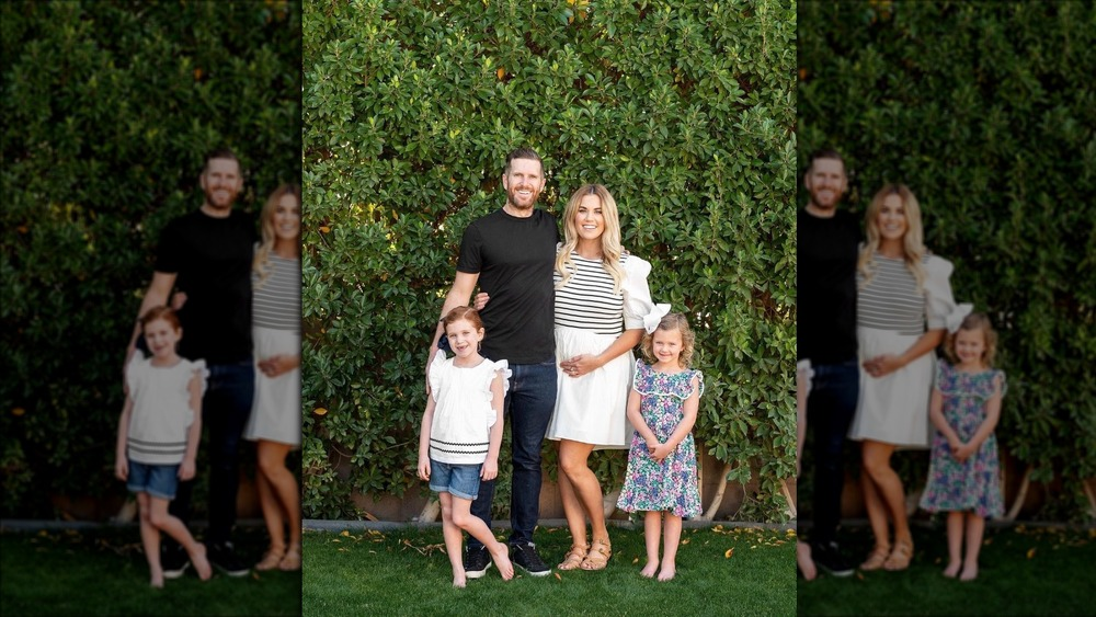 The McGee family poses announcing pregnancy