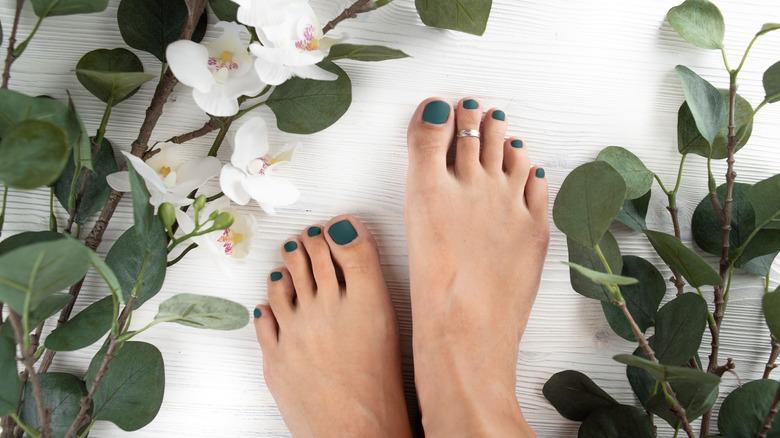 Toes with green nail polish