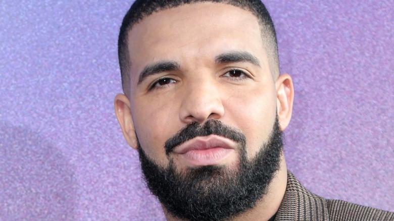 Drake posing at event