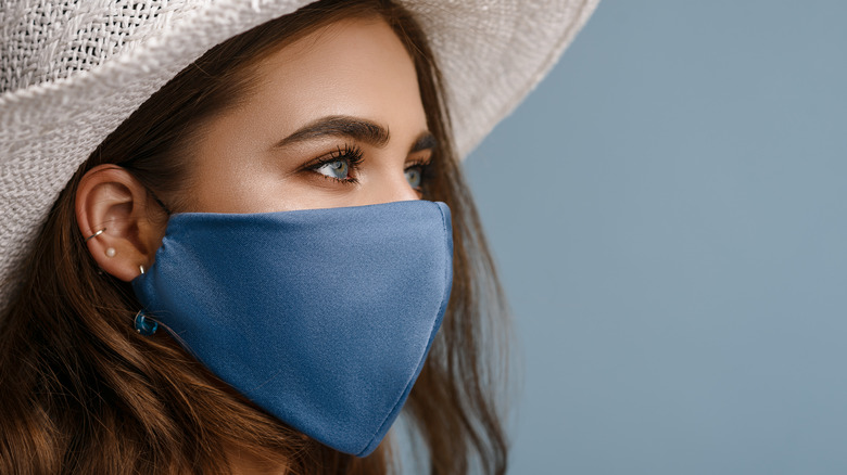 Woman wearing hat and face mask