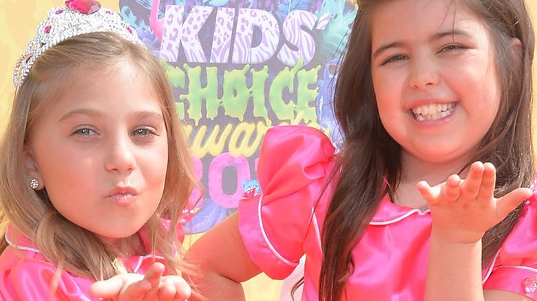 Sophia Grace and Rosie posing