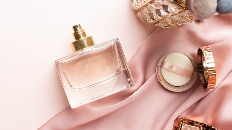 Perfume bottle and pink silk