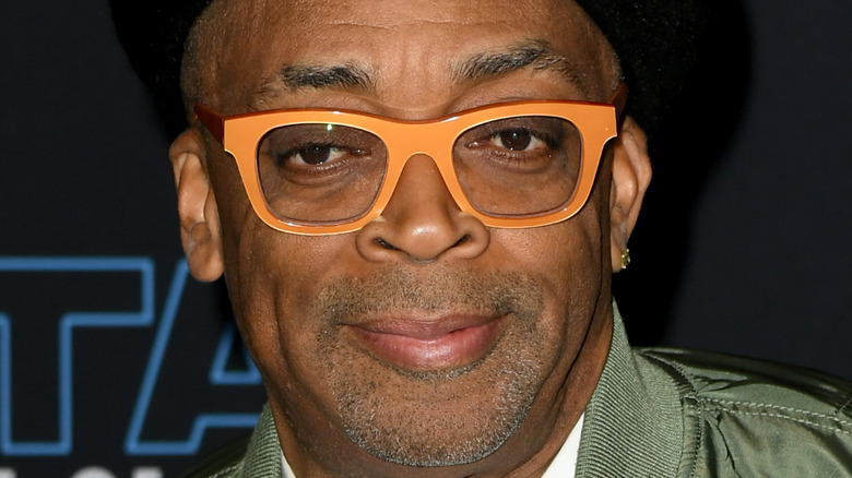Spike Lee grinning in orange glasses