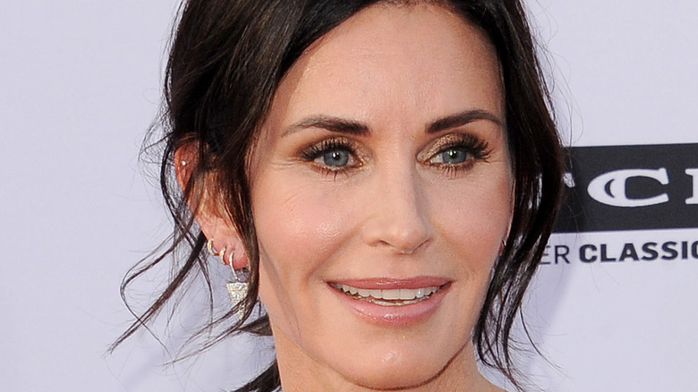 Courteney Cox poses on the red carpet