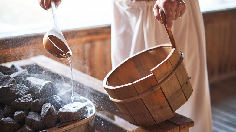 Pouring water on sauna rocks