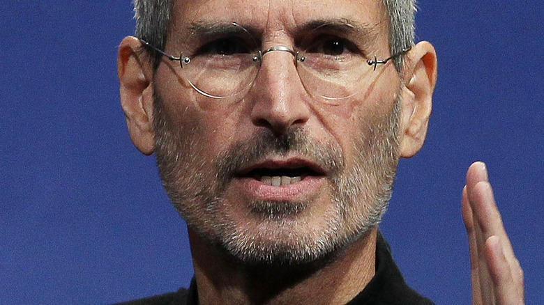 Steve Jobs in trademark outfit