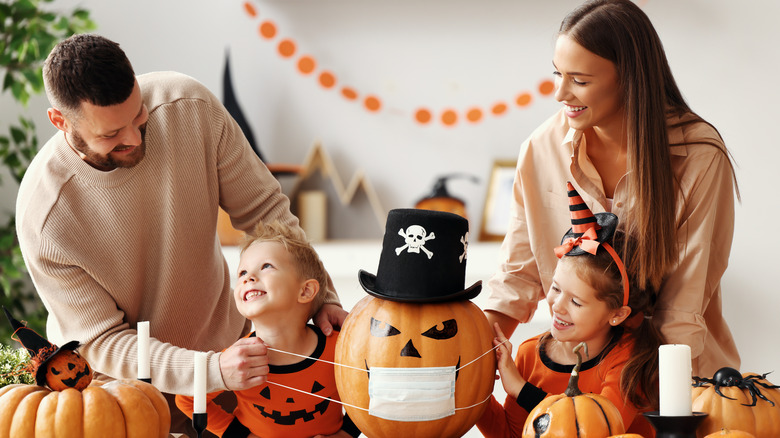 family laughing with Halloween decor