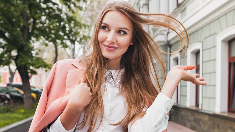 Woman hair toss