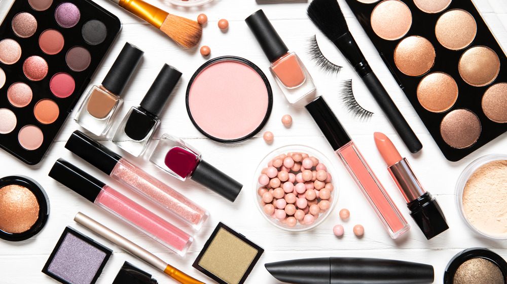 An array of makeup on an all white background