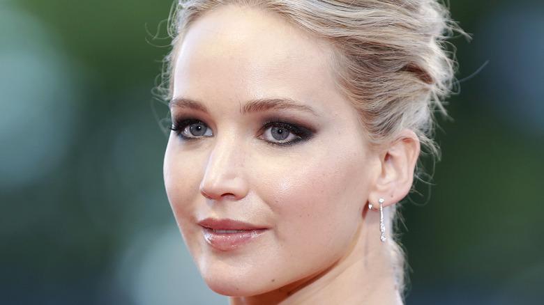 Jennifer Lawrence smiling on red carpet