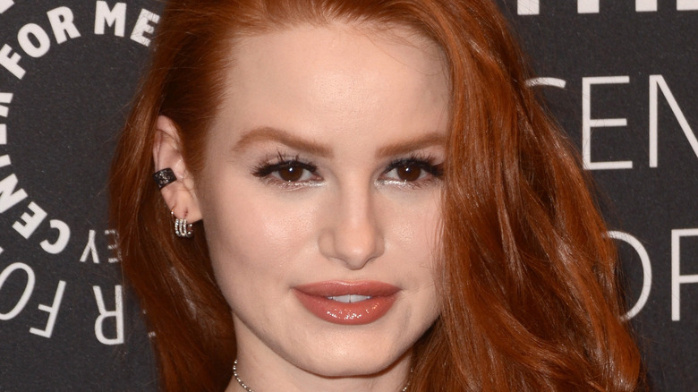 Madelaine Petsch posing on red carpet