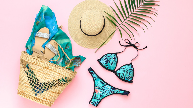 Image of swimsuit, hat, and beach bag