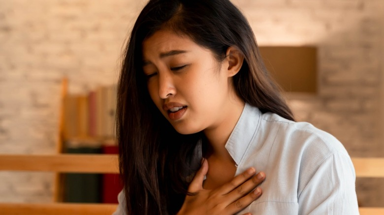 Woman having difficulty breathing