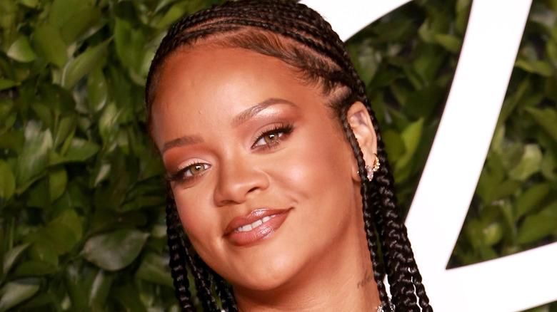 Rihanna smiling on red carpet