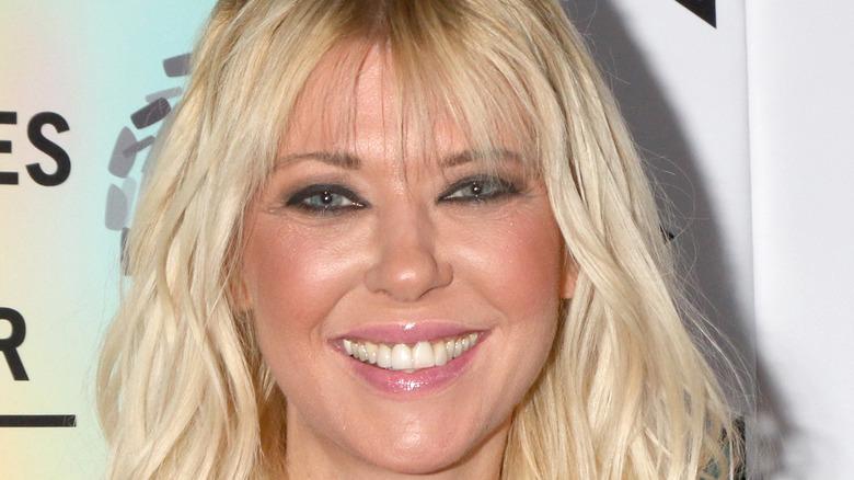 Tara Reid smiles with bangs