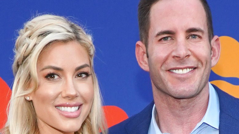 Tarek El Moussa and Heather Rae Young pose together