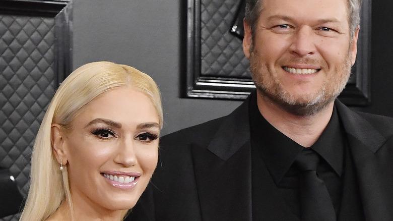 Gwen Stefani and Blake Shelton on red carpet smiling