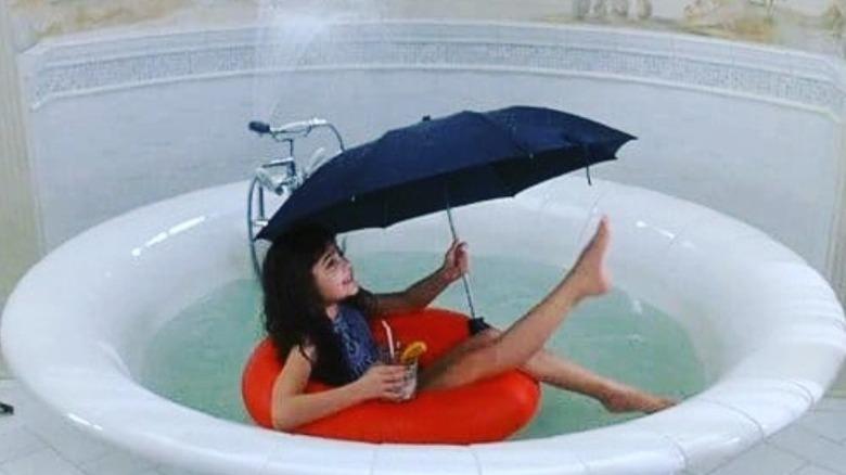Alisan Porter as a child with umbrella