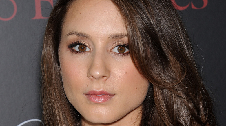 Troian Bellisario posing for a picture at an event in 2014