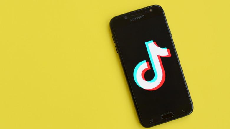 TikTok logo on phone