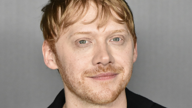 Rupert Grint giving the camera a half smile