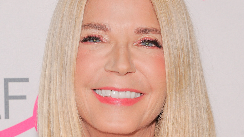 Candace Bushnell smiles big at an event