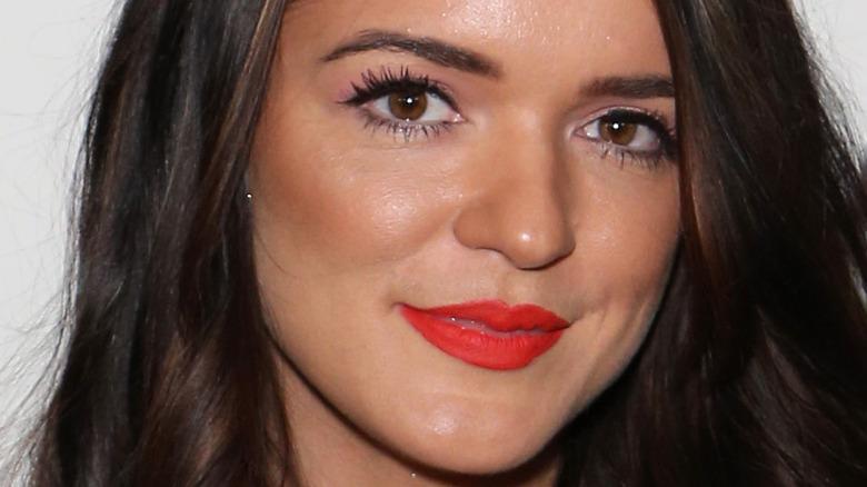 Raven Gates wears red lipstick