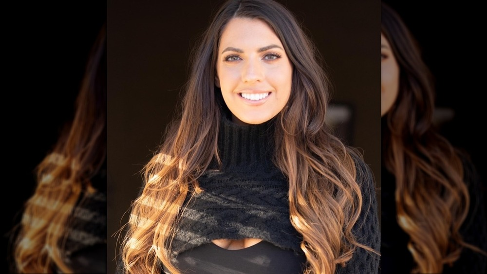 Victoria Larson smiles wearing black