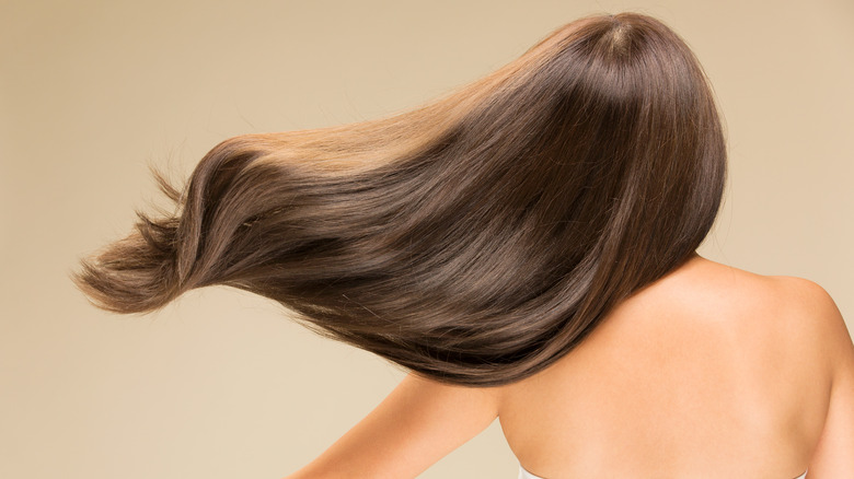 Woman with straight, bouncy hair