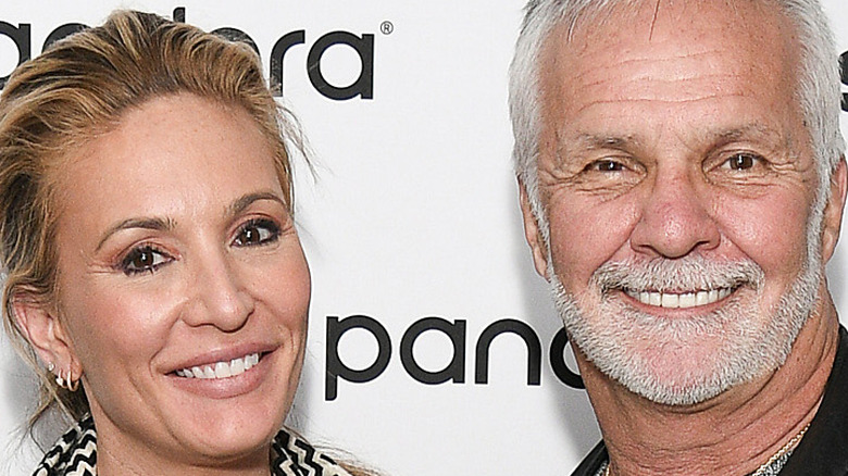 Below Deck stars Kate Chastain and Captain Lee pose together