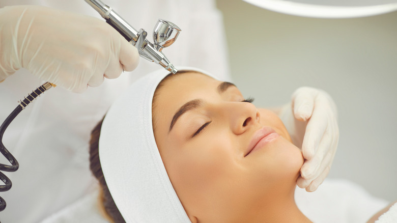 young woman getting oxygen facial