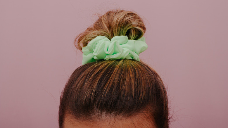 hair tied up with scrunchie