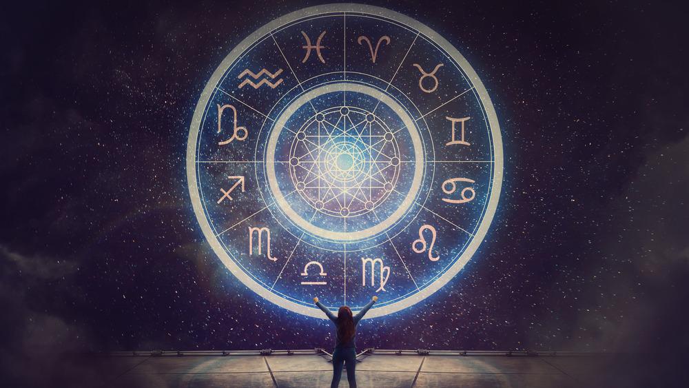 Woman arms raised zodiac signs