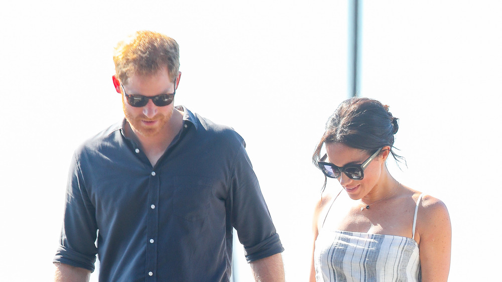 Prince Harry and Meghan Markle walking