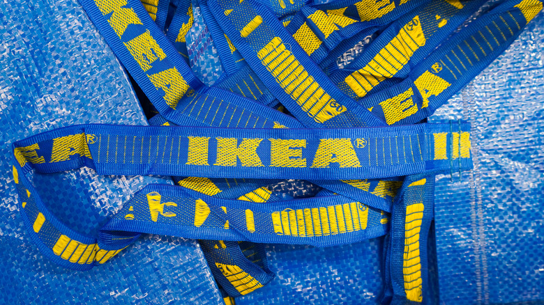 Close up of yellow and blue Ikea tote bags