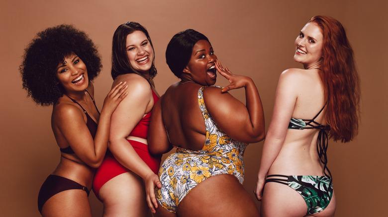 Multiple women in swimsuits.