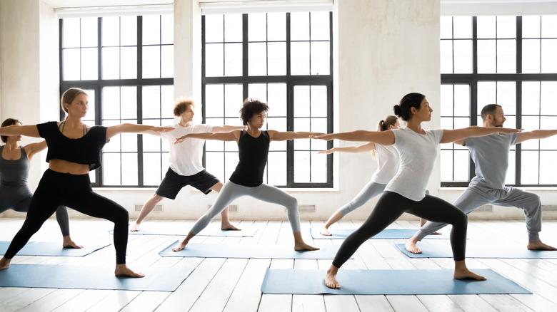 group doing yoga class