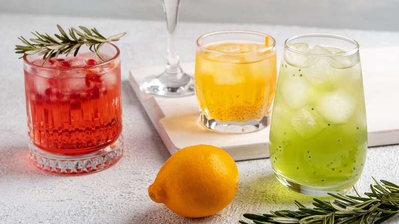 cocktails on table with rosemary and lemon