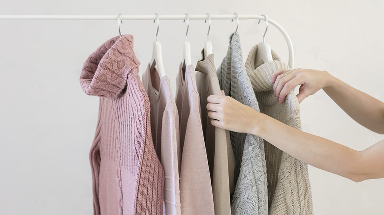 \Woman selecting sweater colors