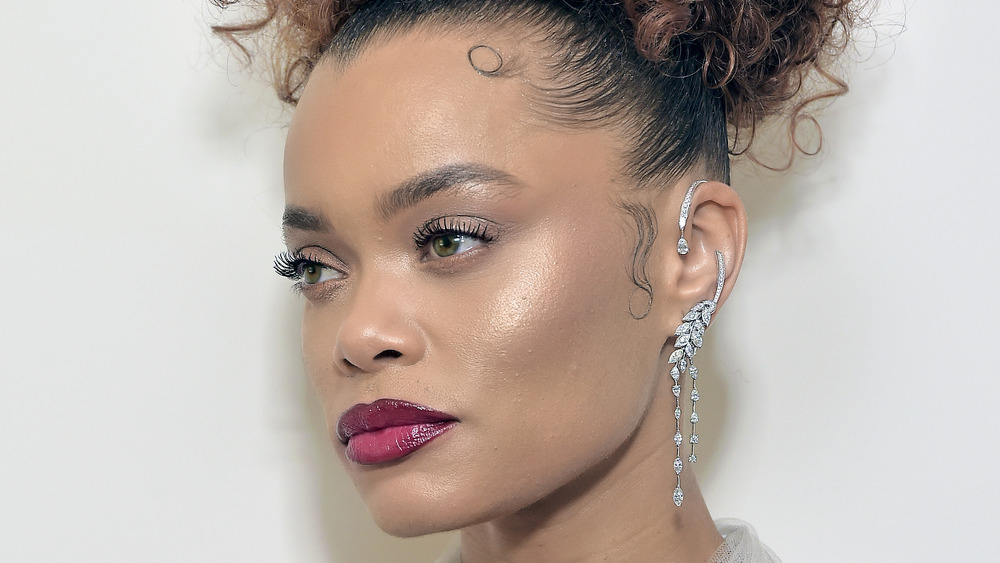 Andra Day with a curly updo